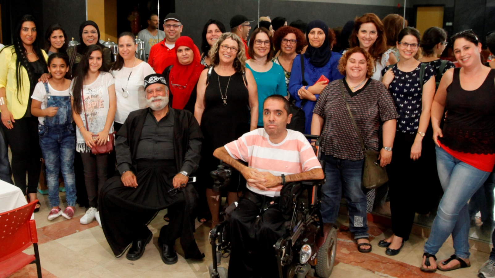 Beit Issie Shapiro parent leaders from Ra'anana and Kalansua at the Sindian Center. Nawaf Zmiro, head of the Sindian Center's Family Advancement Center, is in front in the wheelchair. Photo: courtesy