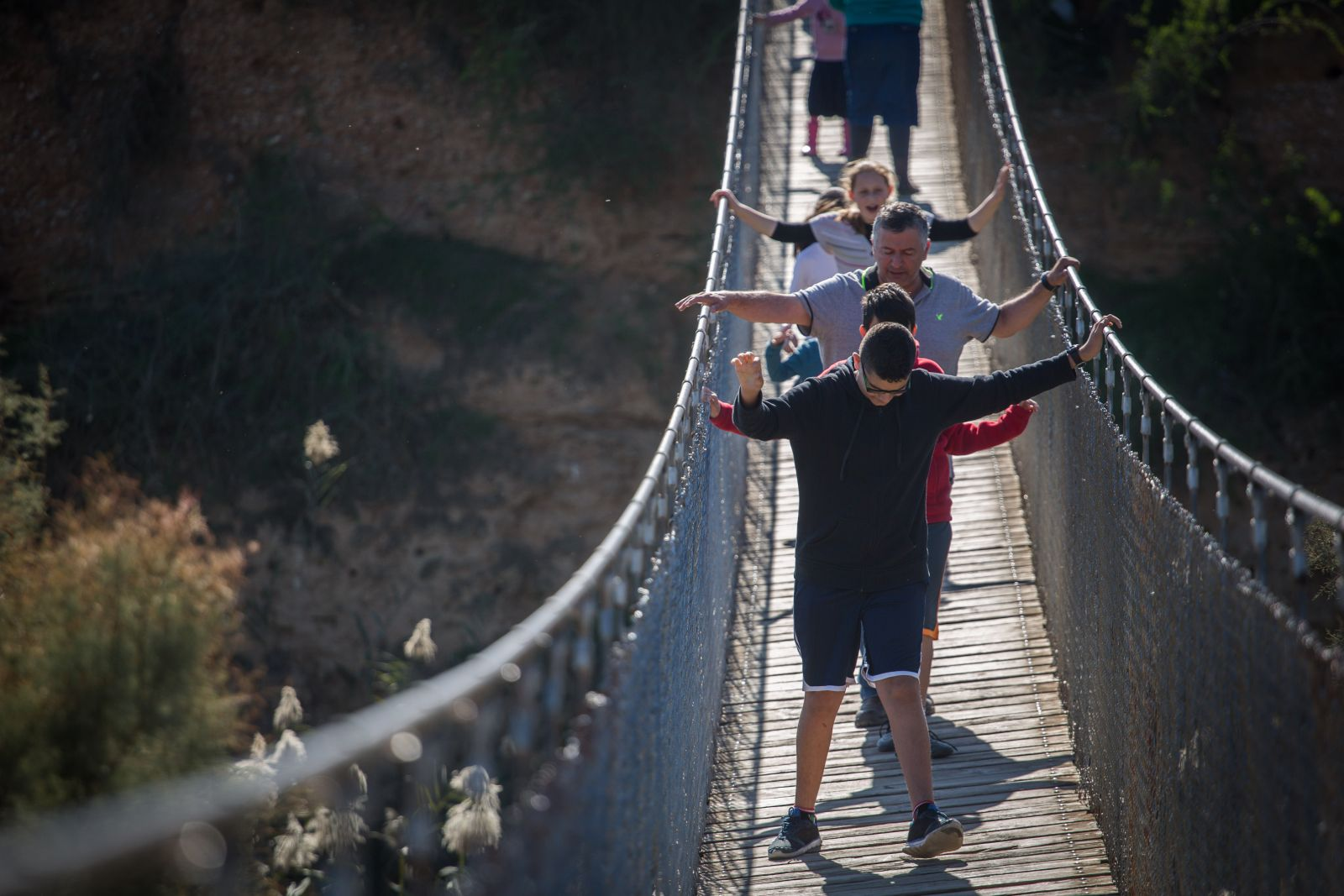 Israelis cross the hanging bridge at Besor River. Photo by Hadas Parush/FLASH90