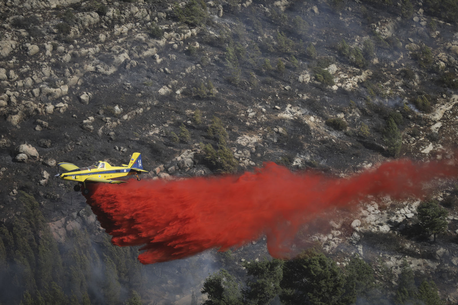 Israeli firefighter aircraft try to extinguish a forest fire near Neve Ilan, outside of Jerusalem on November 24, 2016. Photo by Yonatan Sindel/Flash90