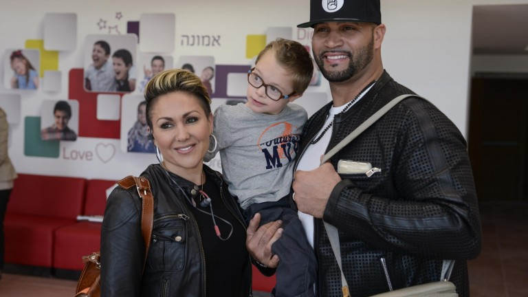 Major League Baseball's Albert Pujols and his wife Deidre hug a child at the Shalva National Children's Center in Jerusalem. Photo by Omer Burin