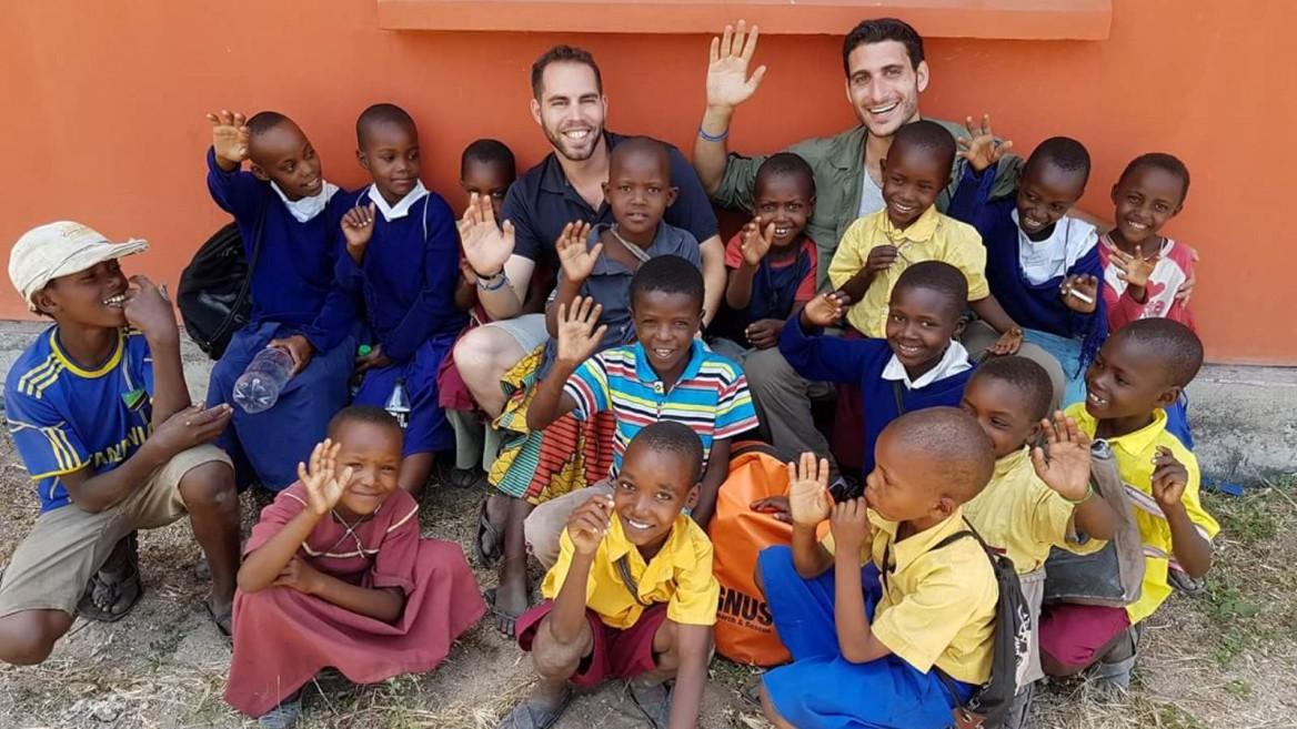EwB TAU students Imry Atzmon, left, and Adir Shaham with schoolchildren in Minjingu, Tanzania, October 2016. Photo via Facebook