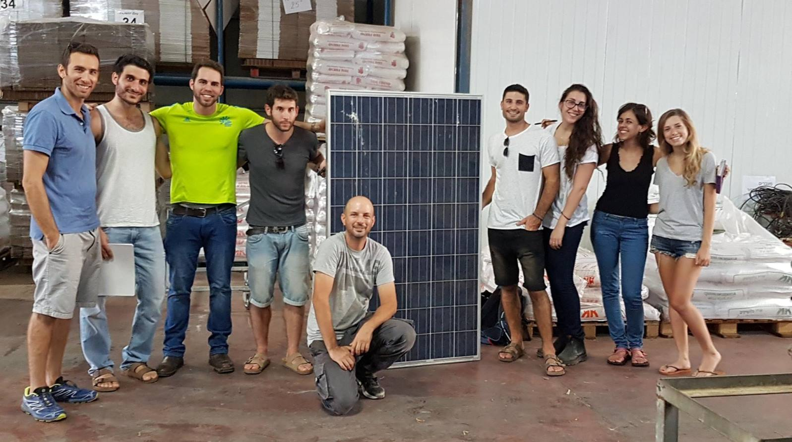 EwB Israel CEO Jonathan Haran with TAU members Adir Shaham, Imry Atzmon, Gil Margalit, Moshe Gurfinkel, Raz Cohen, Adi Mayersohn, Inbal Tamir and Gal Aviram at the headquarters of Ormash Solar. Photo: courtesy