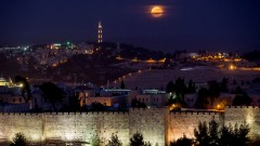 The supermoon rises over Jerusalem's Old City walls on November 14, 2016. Photo by Yonatan Sindel/Flash90