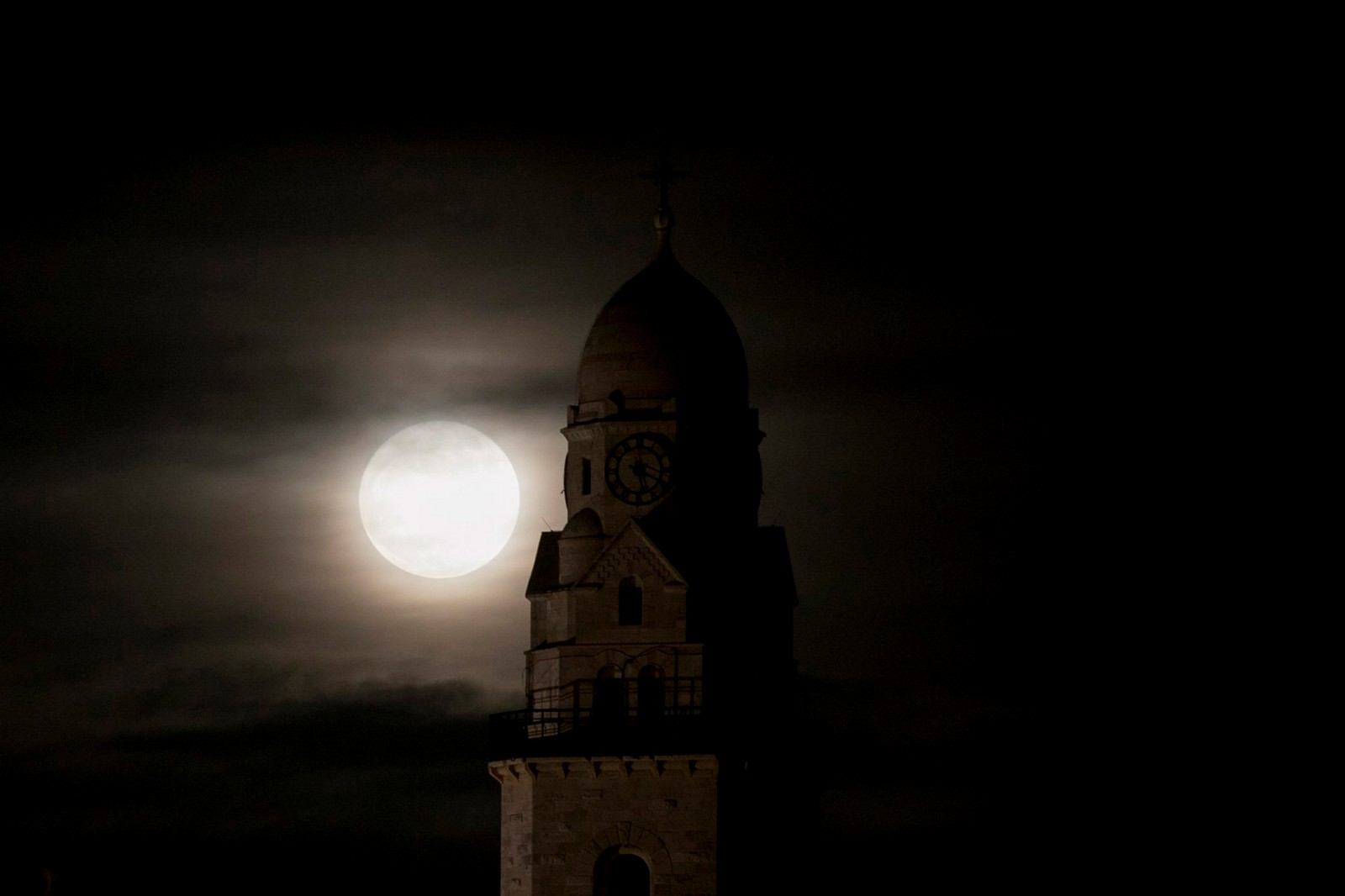 The supermoon rises over the Dormition Abbey in Jerusalem's Old City. Photo by Yonatan Sindel/Flash90