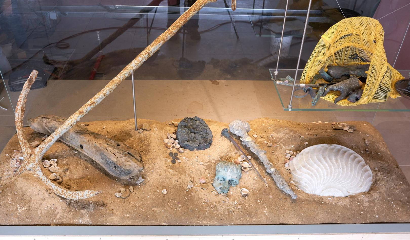 Exhibit of ancient objects found off the coast of Caesarea. Photo by Ardon Bar-Hama