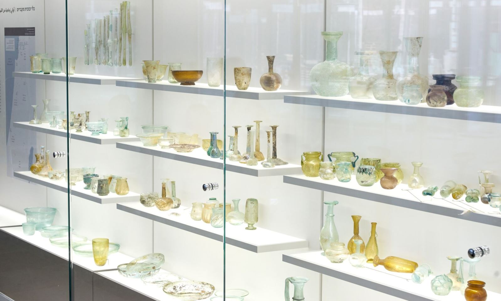 Roman and Byzantine glass in an exhibition showing discoveries as well as ancient furnaces and raw materials used in the producing glass. Photo by Ardon Bar-Hama