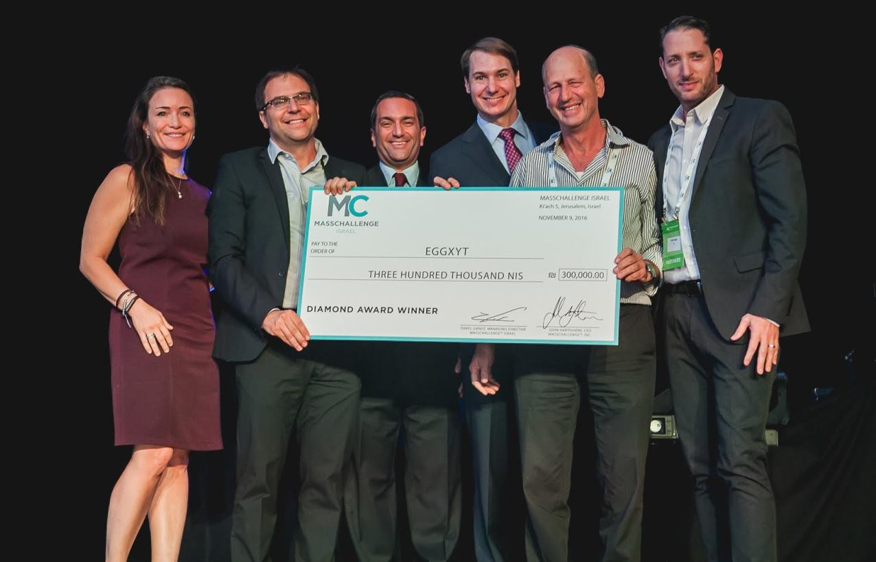 From left, MassChallenge Israel advisory board member Liat Aaronson, EggXYt CEO Yehuda Elram, MassChallenge Israel Managing Director Israel Ganot, MassChallenge CEO and founder John Harthorne, EggXYt CTO Daniel Offen and IoT executive Ariel Hadar, who presented the award. Photo: courtesy