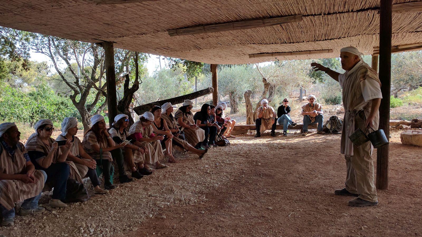 Menachem Goldberg leading a tour group at Kfar Kedem. Photo by Viva Sarah Press