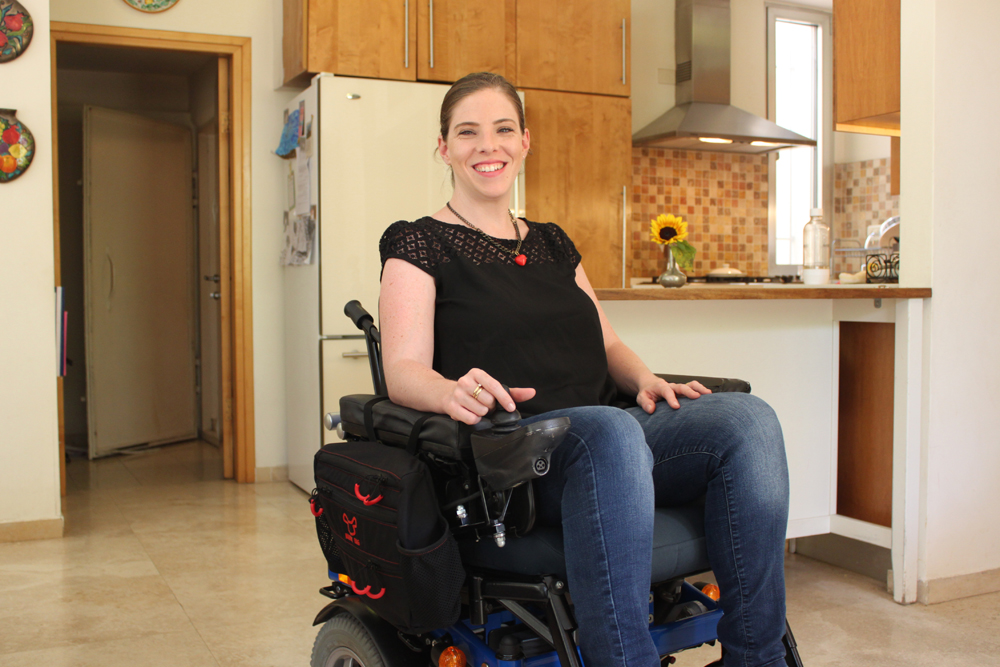 Handy Bag's Side Bag model attaches to the side of an electric wheelchair for one-hand access. Photo: courtesy