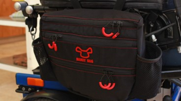 Handy Bag for manual wheelchairs consists of a carrier and a removable bag with two quick-access pockets. Photo: courtesy
