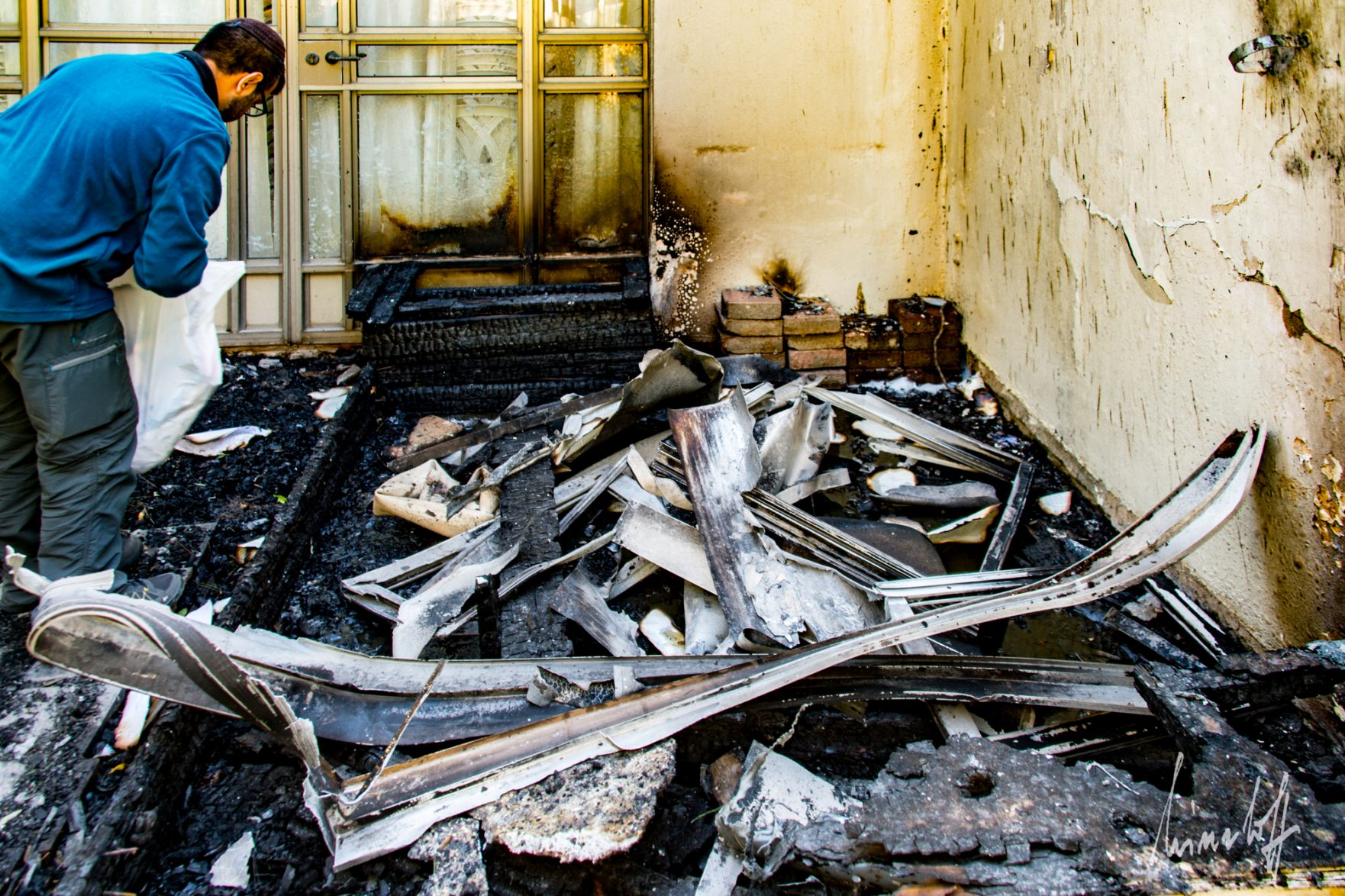 Entrance of the Moriah synagogue after the fire. Photo courtesy of Masorti.org