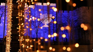 Hanukkah images projected on the Old City walls of Jerusalem. Photo by Mendy Hechtman/FLASH90