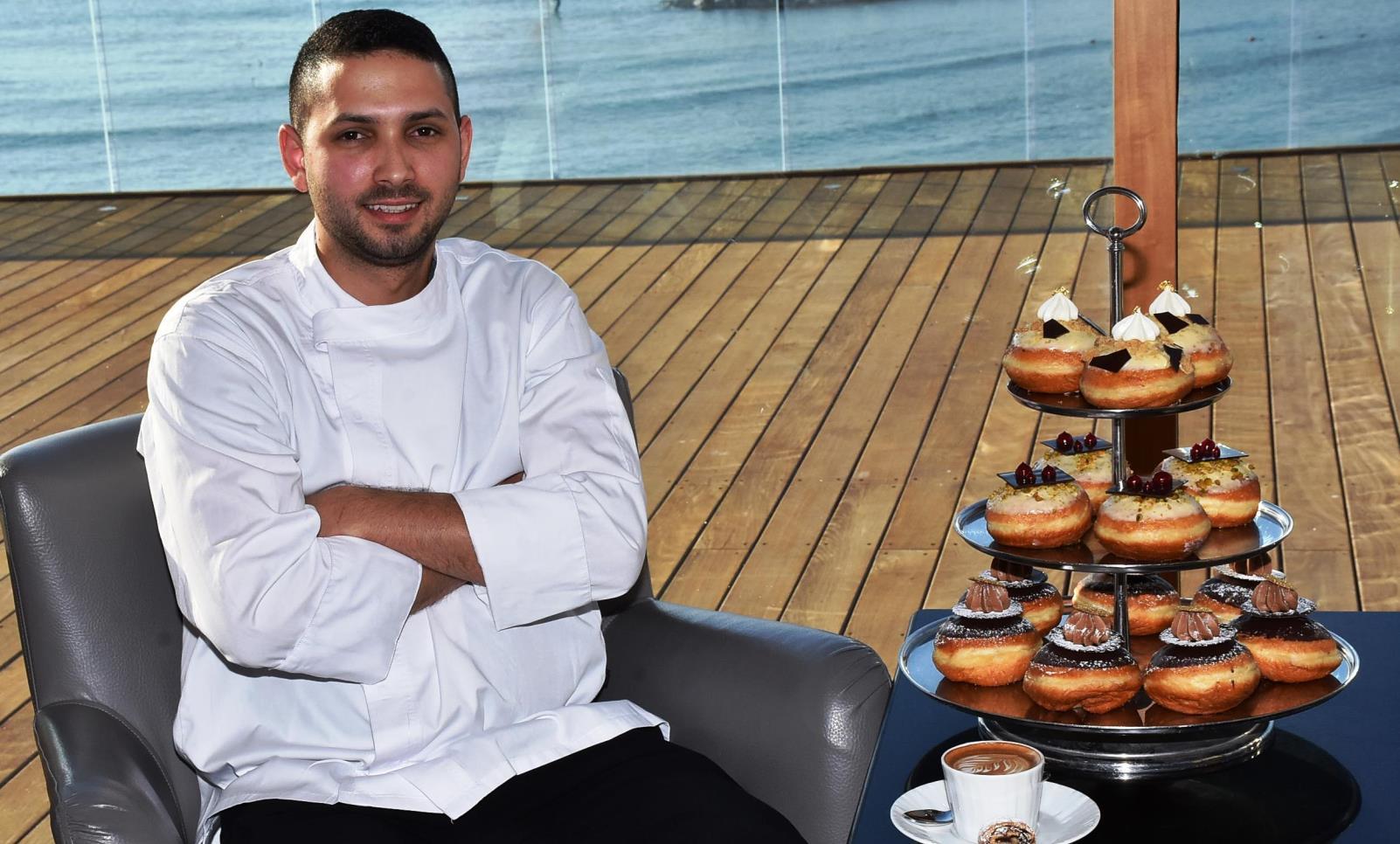 Tel Aviv Hilton pastry chef Idan Hadad, 26, with his Hanukkah 2016 sufganiyot collection. Photo: courtesy