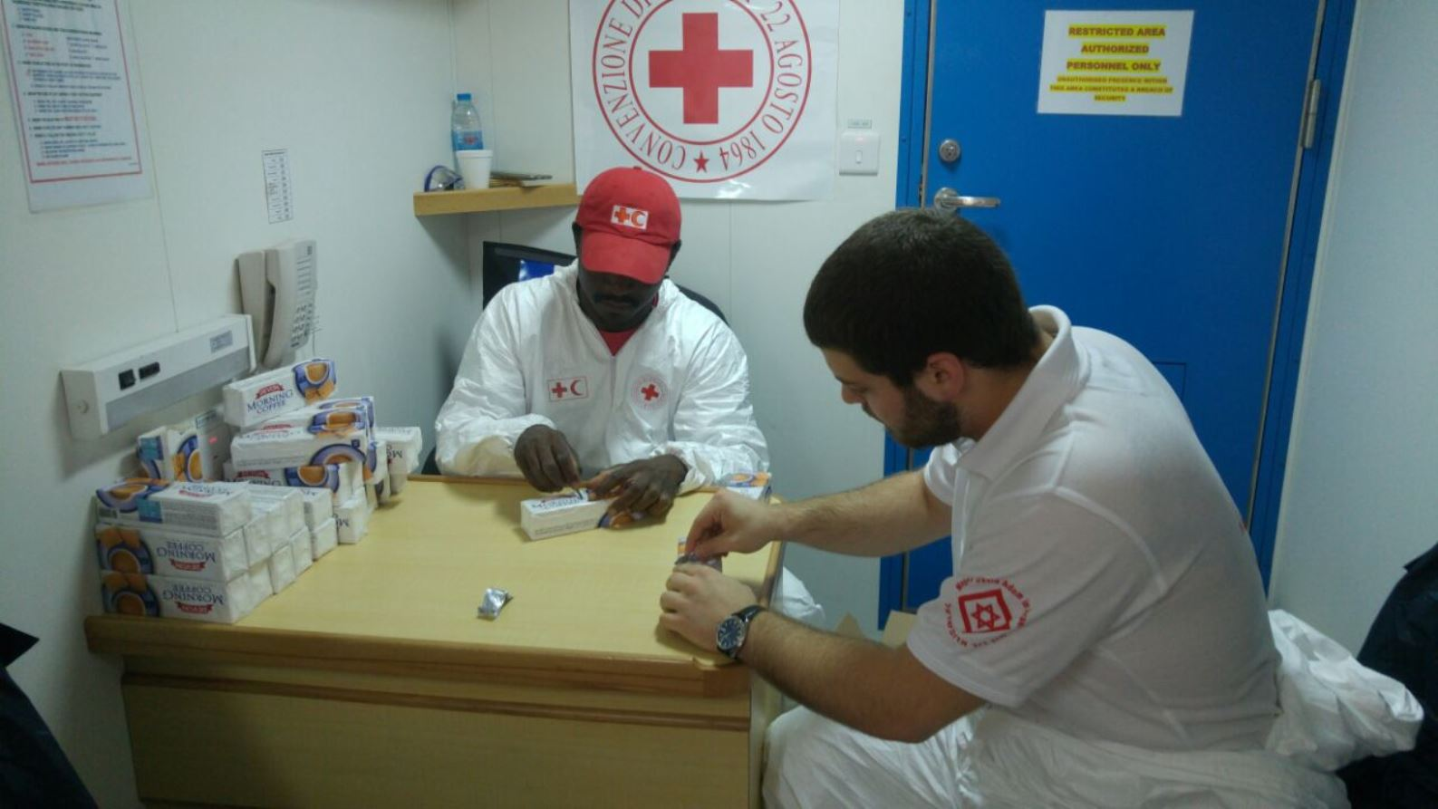 Izzy Papa, right, working with a Red Cross/Red Crescent volunteer. Photo courtesy of MDA