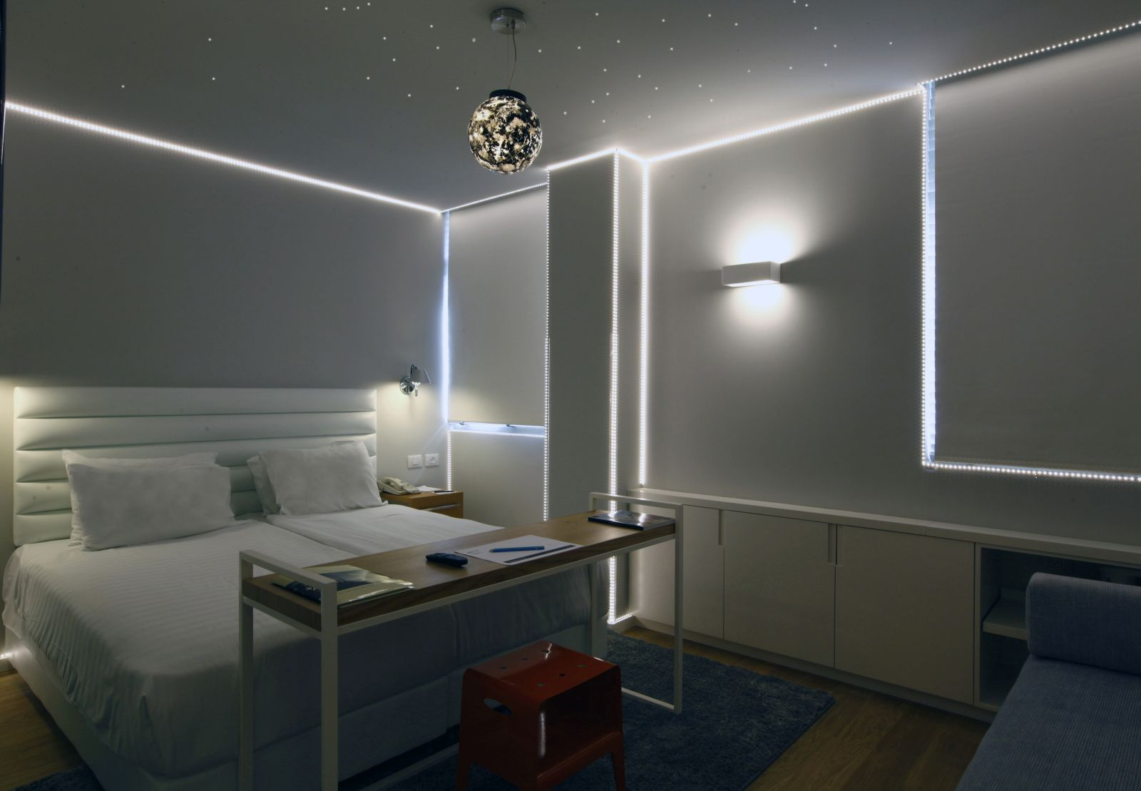 Ron Slavin's works light up this Artplus Hotel room. Photo by Hai Avraham