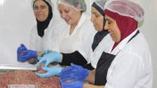 Many of the women employed by Cooking Coexistence have never held a job before. Photo courtesy of Dualis Social Investment Fund