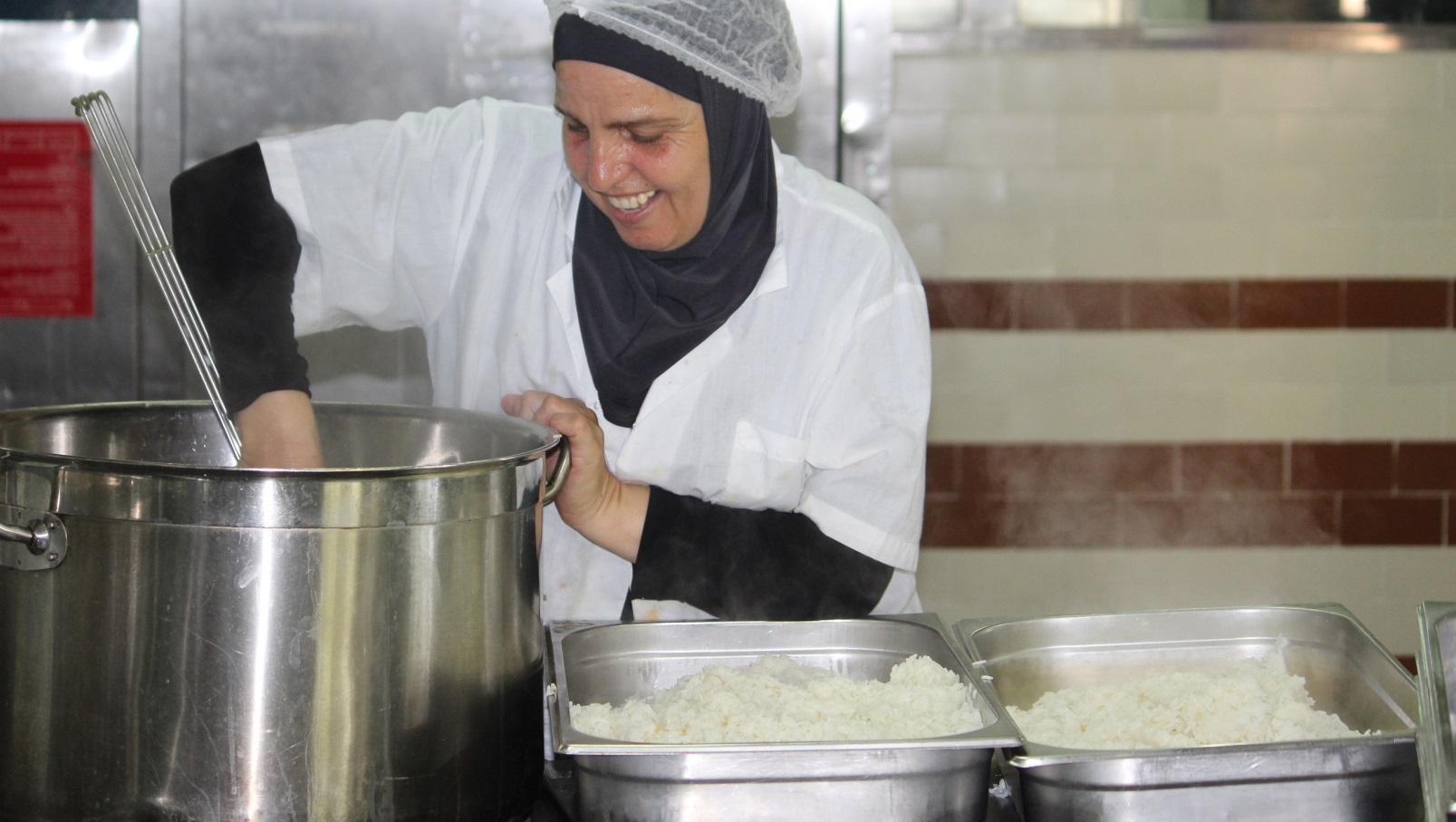 Cooking Coexistence has a triple bottom line. Photo courtesy of Dualis Social Investment Fund