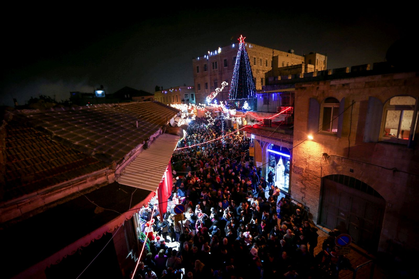 Hundreds of Christians celebrate the lighting of the Christmas tree in the Christian quarter of the Old City Of Jerusalem. Photo by Muath Al Khatib/Flash90.
