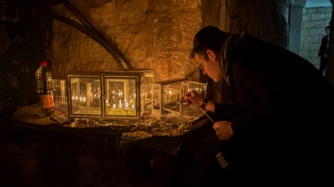 Lighting candles in Jerusalem for Hanukkah. Photo by Alon Kenig/Flash90