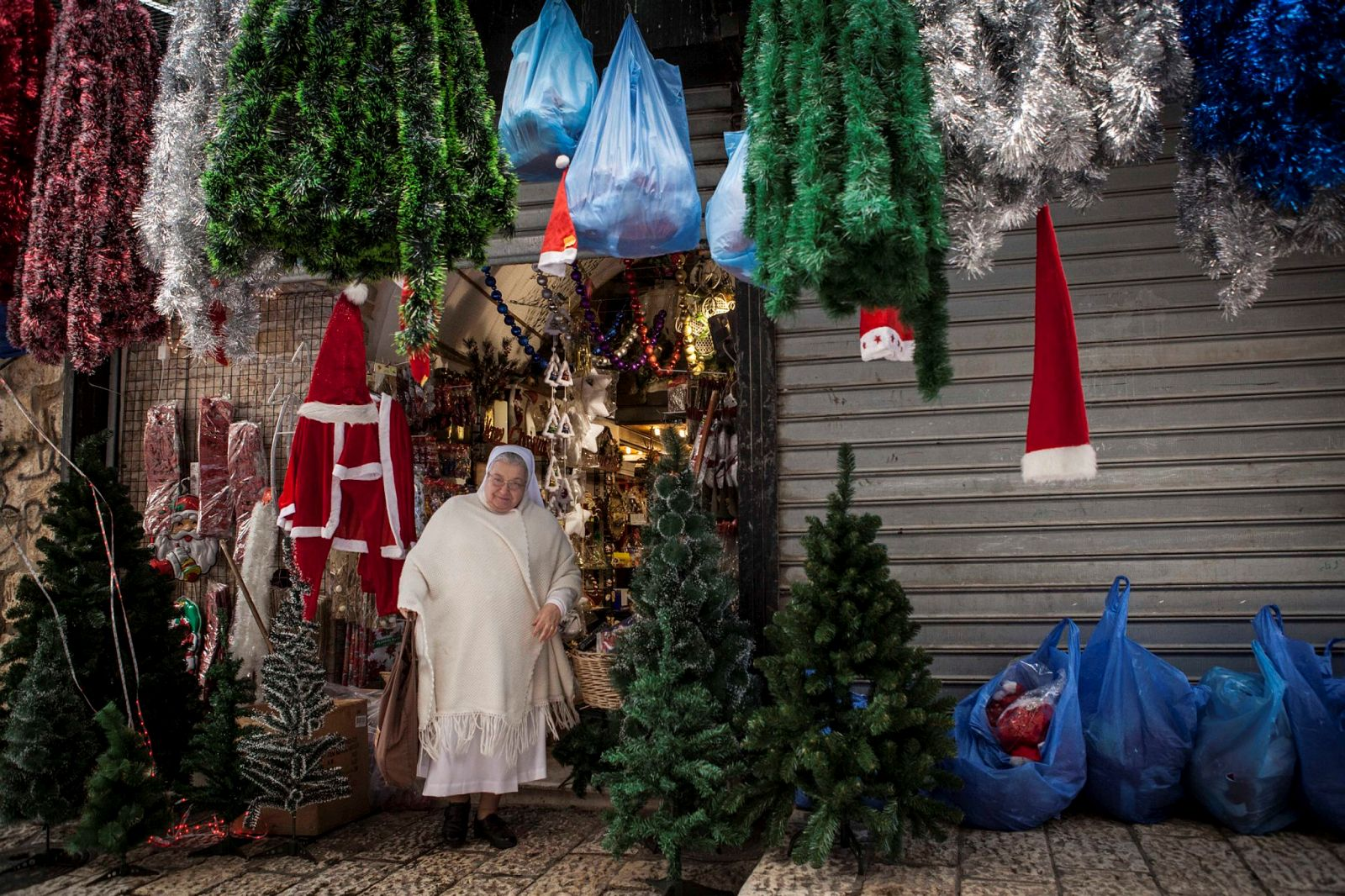 A nun shops for Christmas decorations in a store in the Old City of Jerusalem. Photo by Itay Cohen/Flash90.Jerusalem. Photo by Miriam Alster/Flash90.