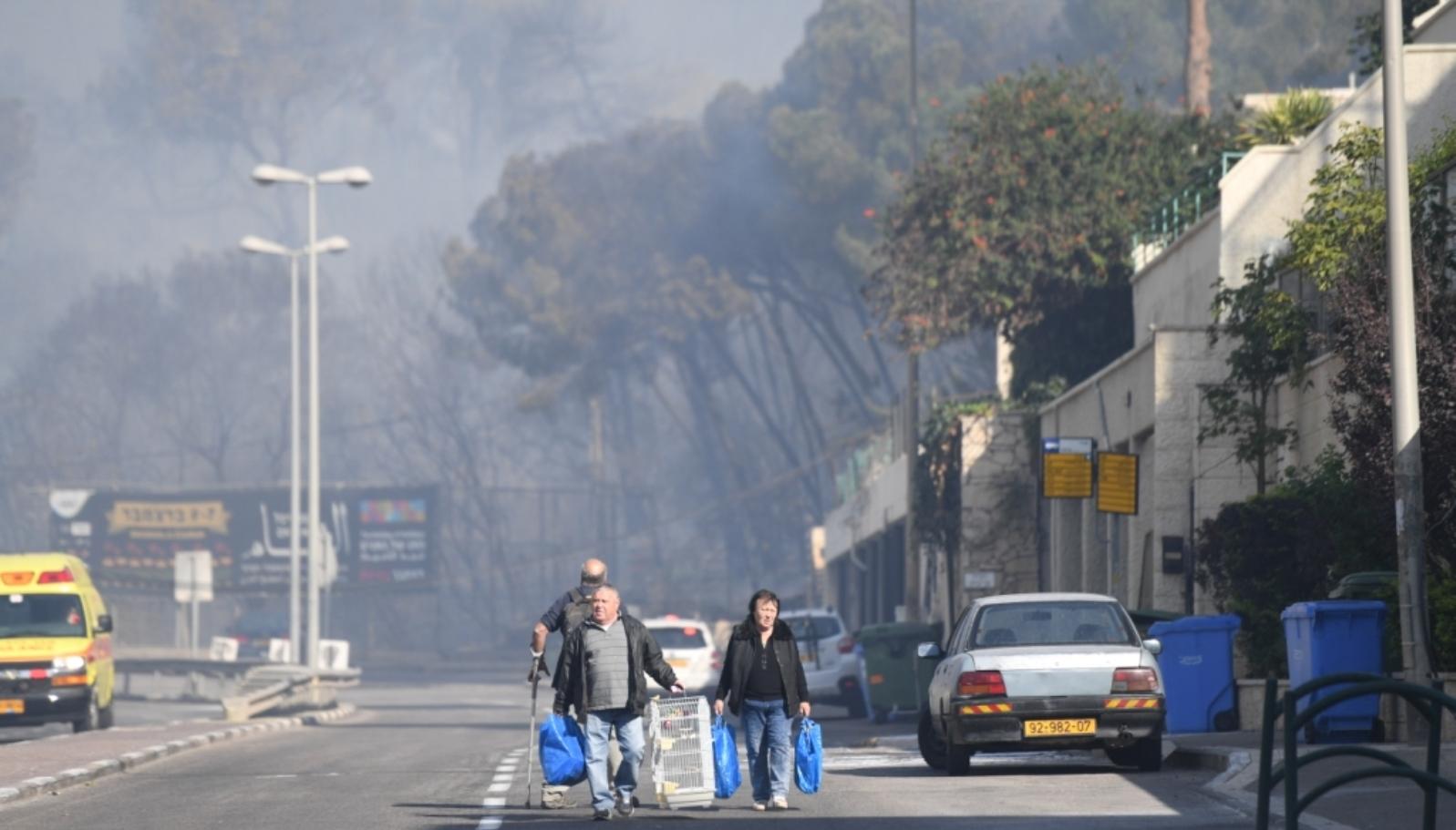 Haifa citizens fleeing the fires, November 2016. Photo courtesy of Haifa municipality