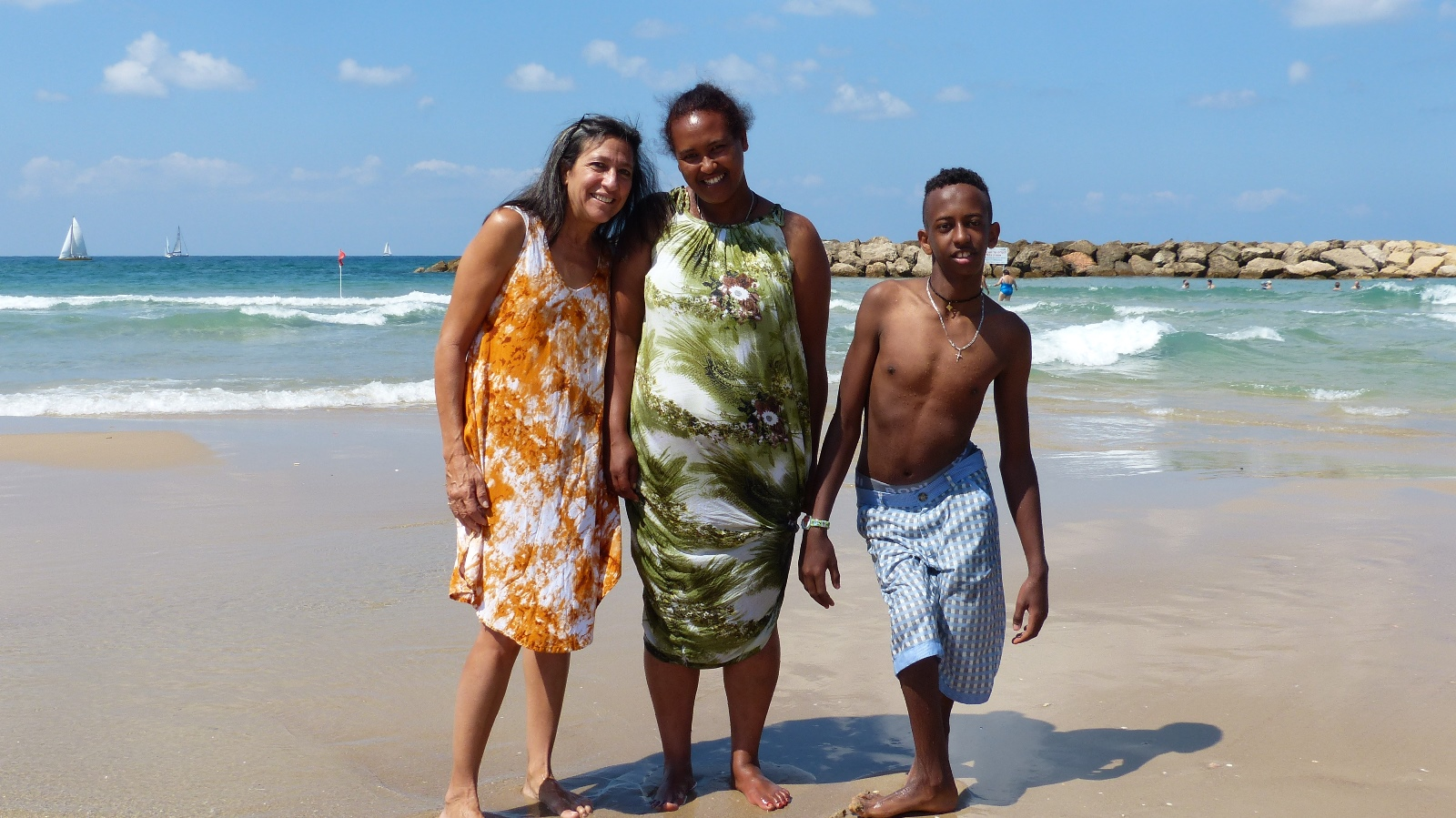 Lori Bacher with Nobel and his mother on the beach in Herzliya. Photo by Doron Bacher