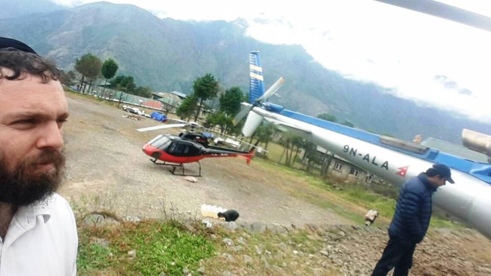 Rabbi Chezi Lifshitz meeting the helicopter that evacuated Akiho Sugiyama. Photo via Facebook