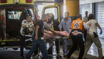 Medics wheel a wounded teen girl into the emergency room of the Shaare Zedek Medical Center. Photo by Yonatan Sindel/Flash90