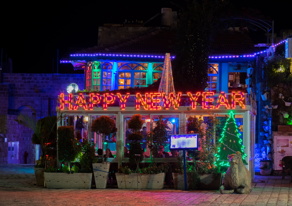 A Happy new year sign on a cafe in Jaffa. Photo by Shutterstock.com