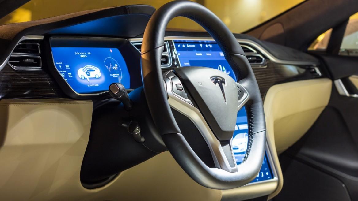 Steering wheel and dashboard of a Tesla Model S. Illustrative photo by Angelus Svetlana/Shutterstock.com