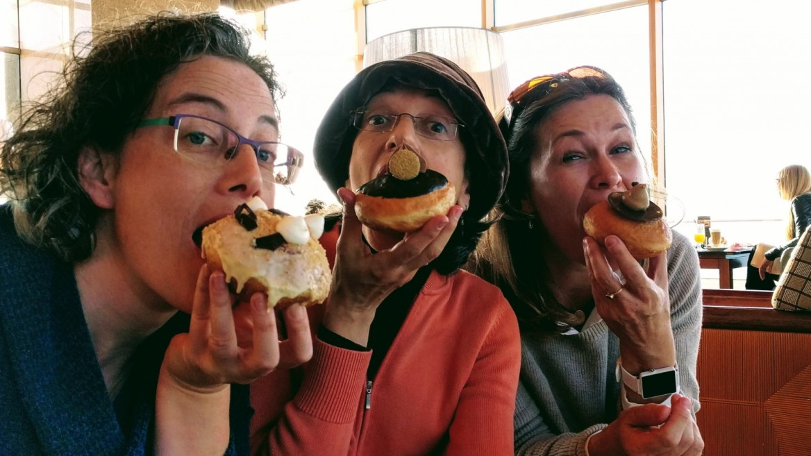 From left, Viva Sarah Press, Abigail Klein Leichman and Nicky Blackburn preparing to indulge in chef Idan Hadad's masterpieces. Photo: courtesy