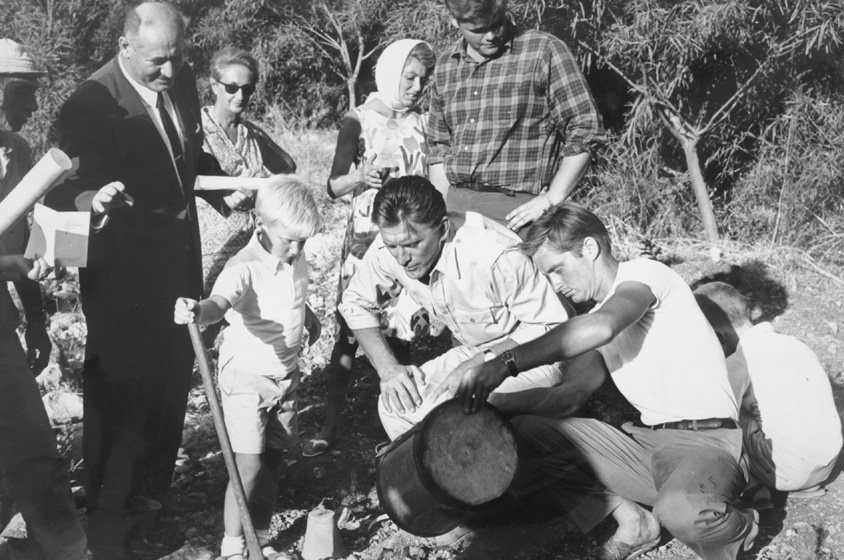 Kirk and Michael Douglas work together to plant a tree in a KKL-JNF forest in Israel in 1965. Photo courtesy of KKL-JNF Archive