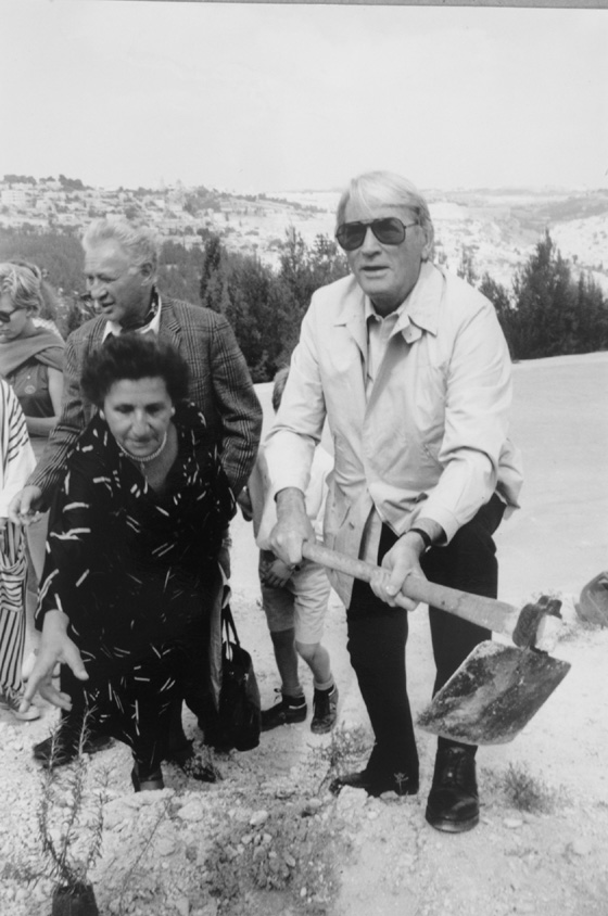 Gregory Peck plants a tree in Hashalom (Peace) Forest in Israel in 1988. Photo courtesy of KKL-JNF Archive