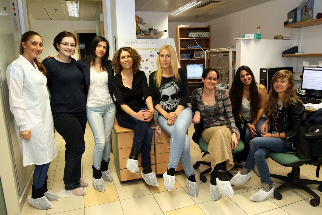 Prof. Mouna Maroun, fourth from left, with her lab group. Photo courtesy of the University of Haifa