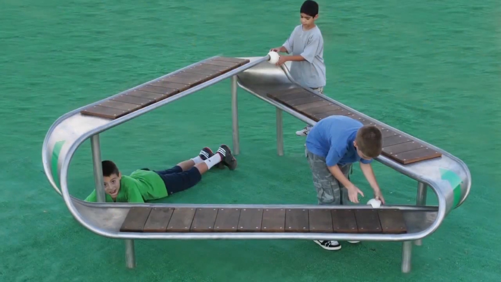 This Mobius bench in the shape of the international recycling logo has only one side and one boundary component. Children slide balls along the bench and observe that a ball starting on the outer side will complete the circle on the inner side. Photo courtesy of ABA Science Play