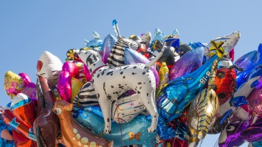 What happens to helium balloons that go astray? In Israel's international airport they're collected for children. Image via Shutterstock.com