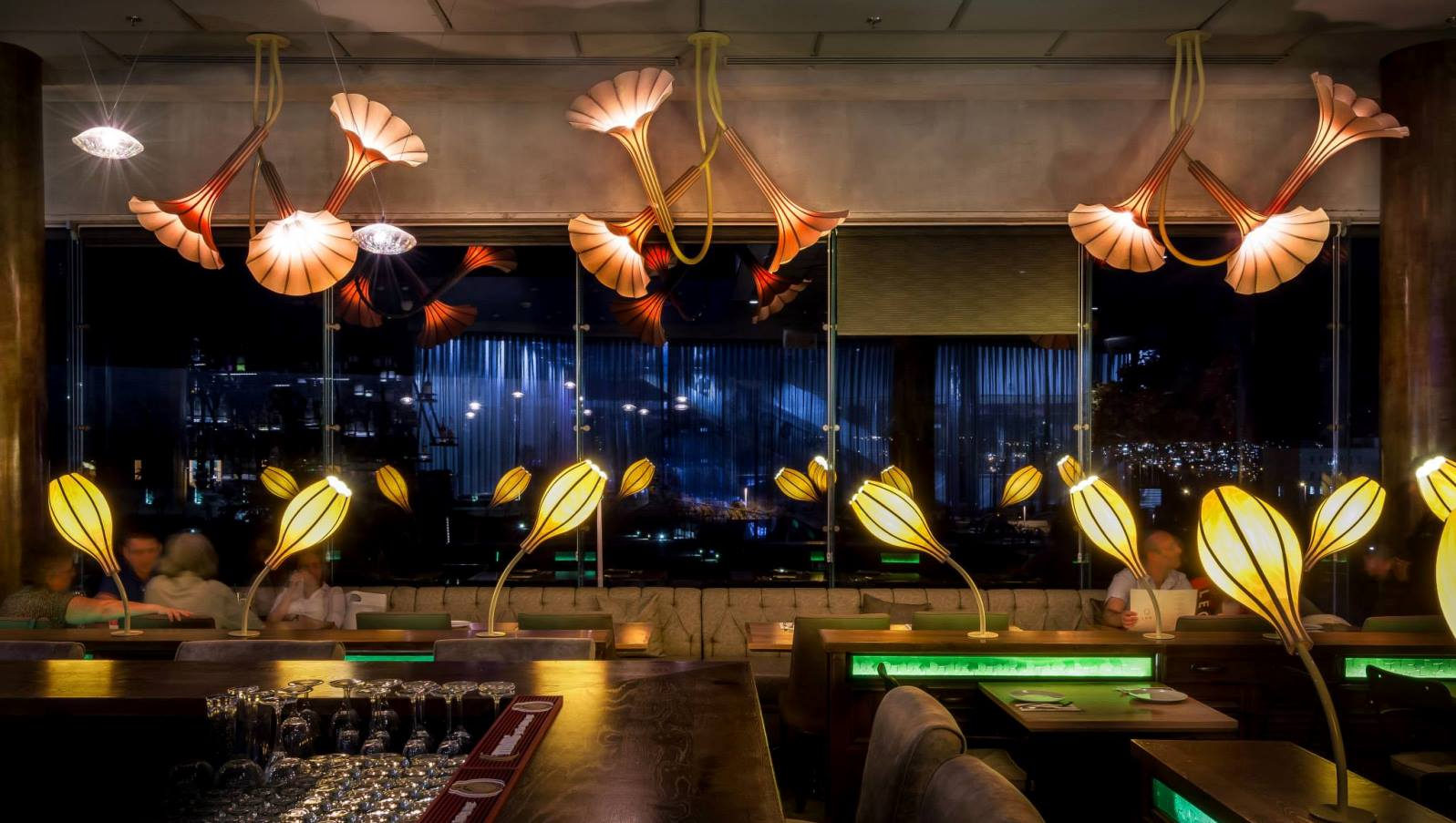Studio Mabua lighting installed in a restaurant. Photography by Itai Aviran