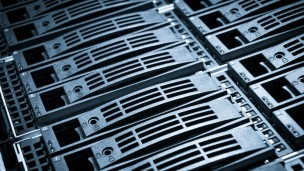 Close-up of hard drives in a data center. Photo via Shutterstock.com