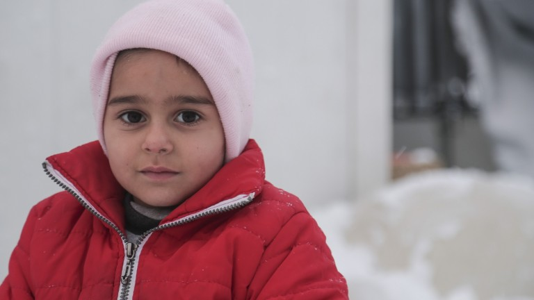 A Syrian refugee child in Greece, January 2017. Photo by Nicolas Economou/Shutterstock