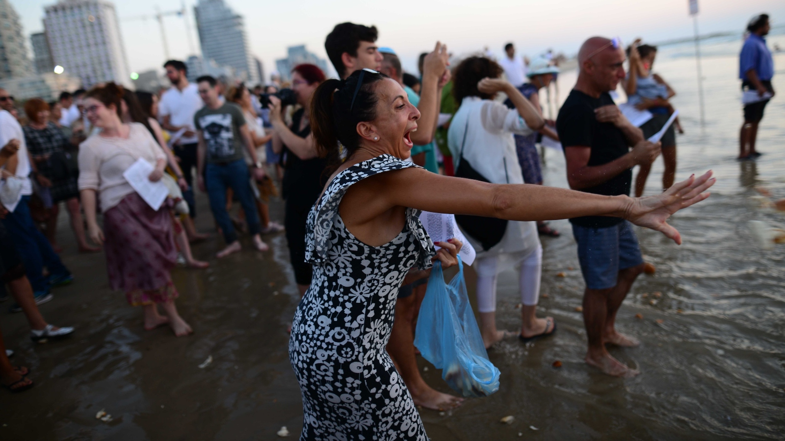 Why people toss breadcrumbs into the sea off Tel Aviv