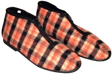 """The classic Israeli cloth """"naal bayit"""" – plaid, ankle-high, with a front zipper and hard rubber sole, perfect for the rainy season. Photo: Nostalgia Online"""