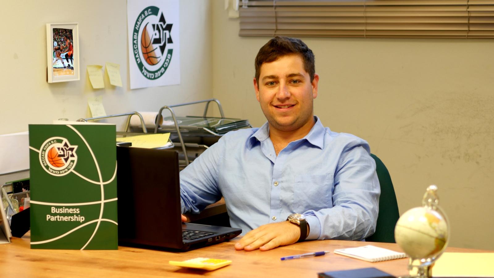 Lawrence Roodenburg from Boston interning at Maccabi Haifa Basketball Headquarters. Photo courtesy of Onward Israel