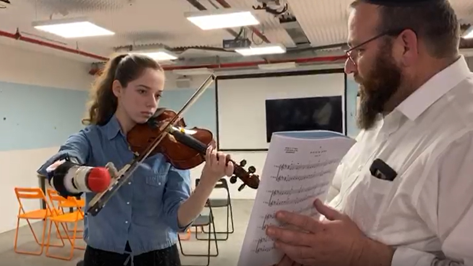 Israeli engineering students design a low-cost prosthesis to fulfill a 16-year-old girl's dream to play the violin.