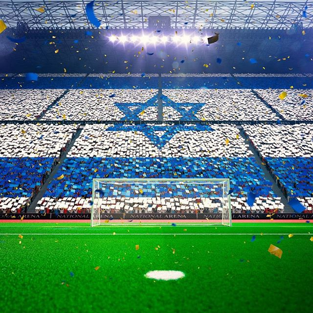 Fans gather to create the #IsraeliFlag at a #soccer game at the #NationalArena!  Photo credit: Oleksii Sidorov