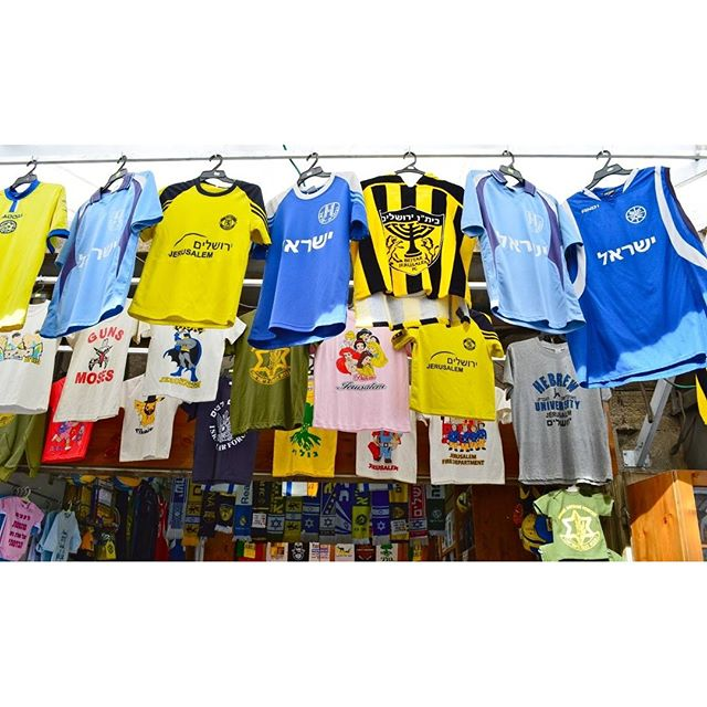 Shirts for all tastes and sizes on Agripas Street in Jerusalem.  Photo credit: Daniel Santacruz