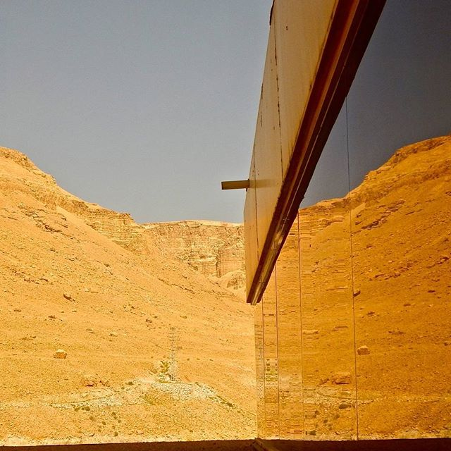 The Judean Desert reflected on the windows of a hotel in #EinBokek, on the shores of the #DeadSea  Photo credit: Daniel Santacruz