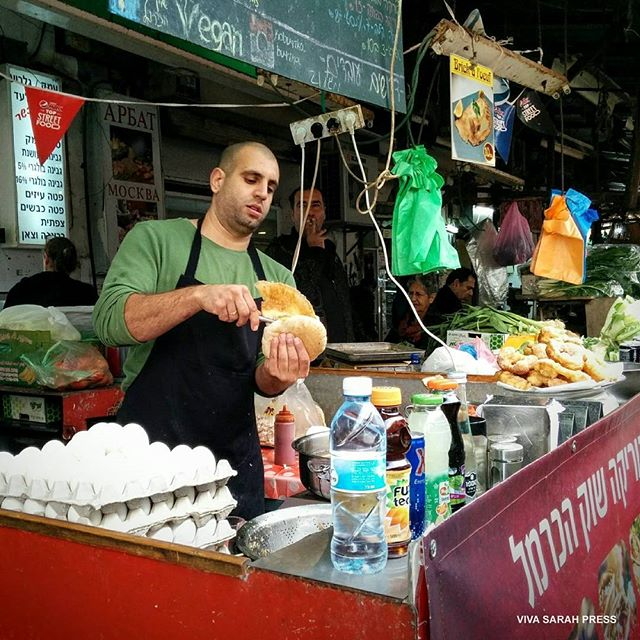Getting ready for lunch at the Carmel Market. #TelAviv #Israel  Photo Credit: Viva Sarah Press