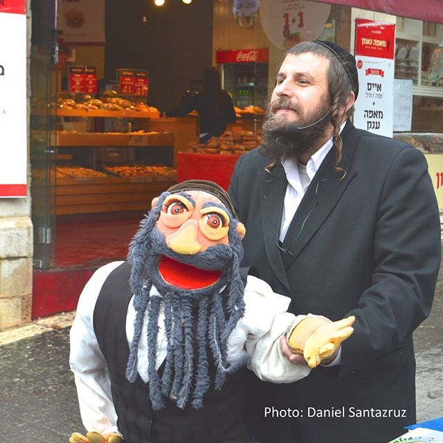 A #ventriloquist entertains passersby in #Jerusalem Photo credit: Daniel Santacruz
