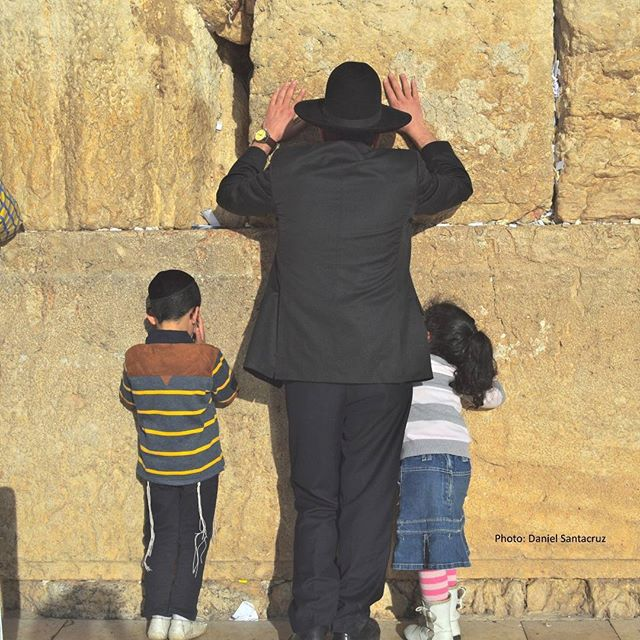 A father and his children pray at the #Kotel, in #Jerusalem. #Israel Photo credit: Daniel Santacruz