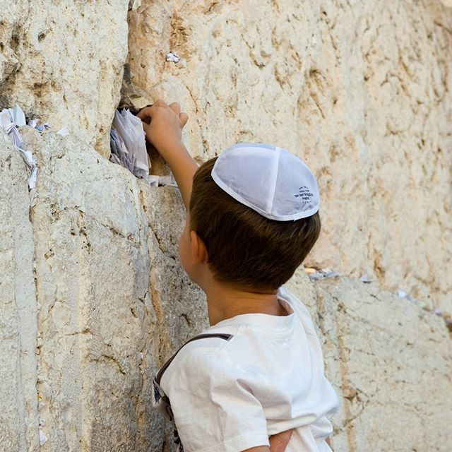 A young boy making a #wish at the #WesternWall. #Jerusalem  Photo credit: Robert Hoetink